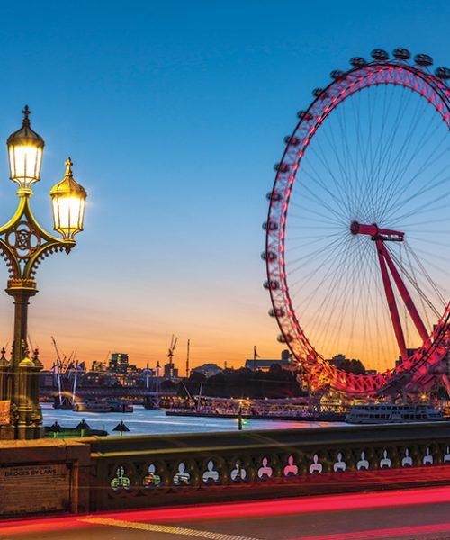 Street lamp on Westminster Bridge with London Eye in background, London, UK